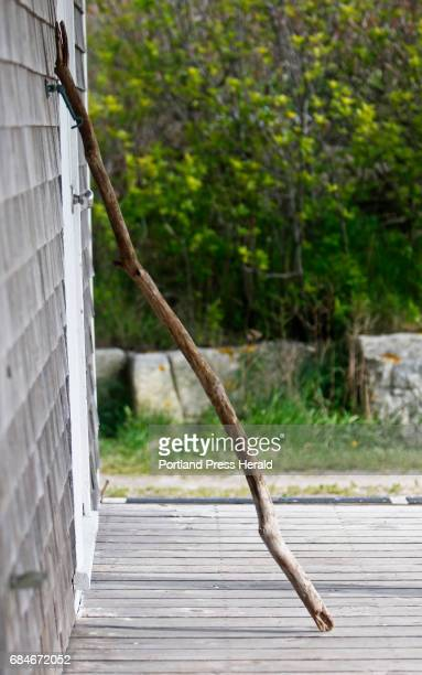 A walking stick rests at Founder's Hall aka Anderson's Cottage during a visit to Appledore Island where famous American impressionist Childe Hassam...