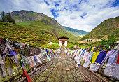 Walking suspension bridge with colorful prayer flags in Bhutan