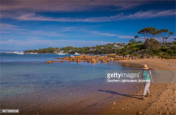 Walking the beach at Freycinet National Park, east coastline of Tasmania.