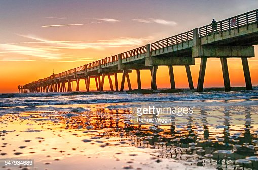 Fishing pier at sunrise stock photos and pictures getty for Jacksonville fishing pier