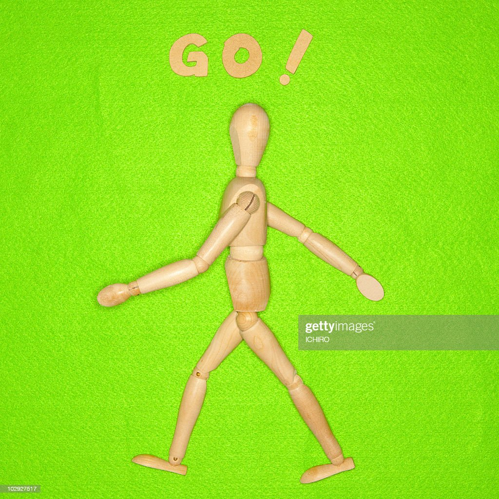 Walking toy and 'GO!' sign. : Stock Photo