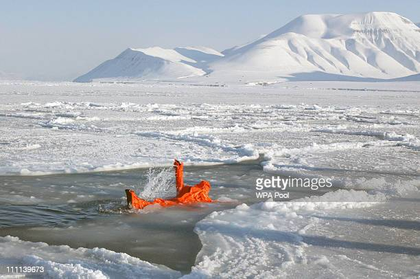 Walking with the Wounded team member tries out an immersion suit on the island of Spitsbergen situated between the Norwegian mainland and the North...