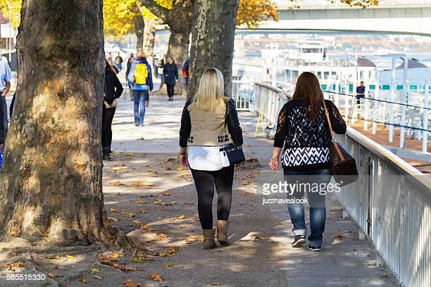 Walking women near Rhine