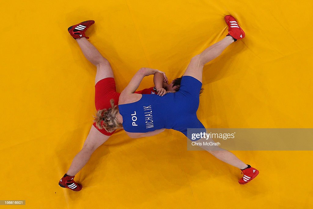 Walkley Press Photographer of The year Portfolio and Sport category Finalist on November 22, 2012 in Singapore. Caption: Mi Gyong Choe (red) of DPR Korea competes against Monika Ewa Michalik of Poland during their Women's Freestyle 63 kg Wrestling match on Day 12 of the London 2012 Olympic Games at ExCeL on August 8, 2012 in London, England.