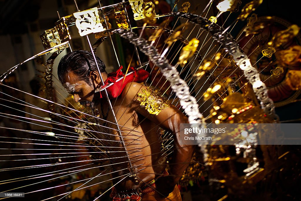 Walkley Press Photographer of The Year Portfolio on November 22, 2012 in Singapore. Image Caption: A devotee has his body pierced with hooks before taking part in the Thaipusam procession at Sri Srinivasa Perumal Temple on February 7, 2012 in Singapore. Thaipusam is a Hindu festival celebrated on the full moon in the Tamil month of Thai. Devotees pray and make vows, when the prayers are answered they fulfill the vows by piercing parts of their body such as their cheeks, tongues, and backs before carrying a 'Kavadi' along a four kilometre route.