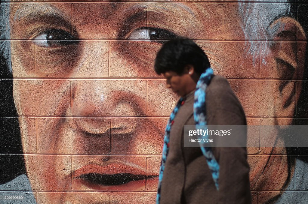 A walks near a graffiti painted to welcome Pope Francis near the esplanade where Pope Francis will give a mass for 300 thousand people during the preparations ahead the visit of Pope Francis to Mexico at Las Americas on February 11, 2016 in Ecatepec, Mexico.