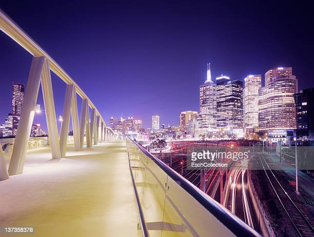 Walkway and train tracks with skyline of Melbourne