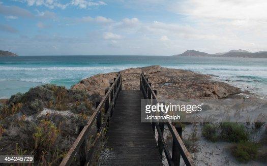 Walkway leading to pristine beach : Stock Photo