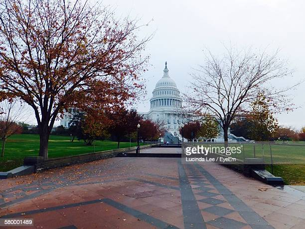 Walkway Leading Towards Capitol Building Against Clear Sky