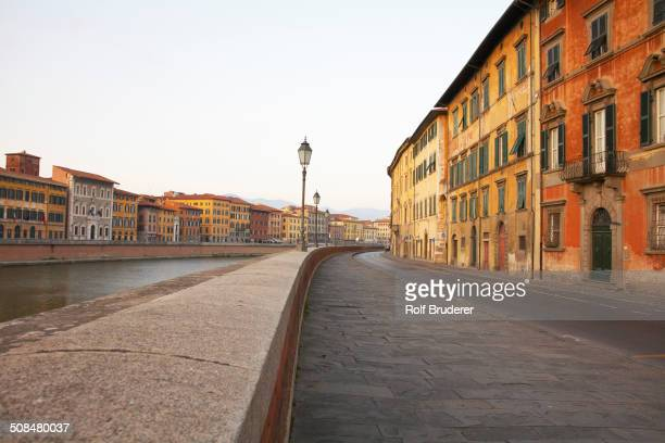 Walkway on urban riverfront, Pisa, Toscano, Italy
