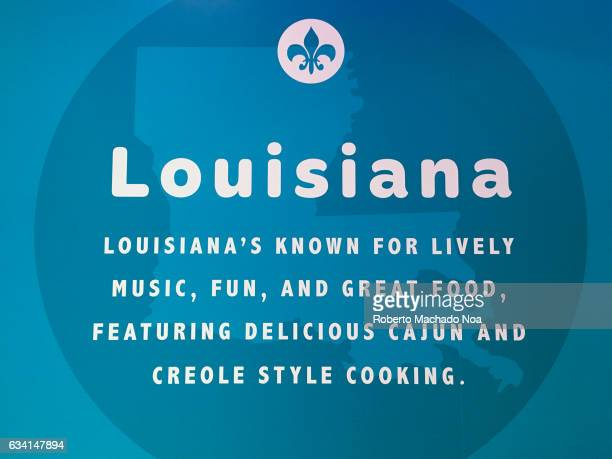 Wall advertisement in Popeyes Louisiana Kitchen about their creole and cajun style of cooking chicken