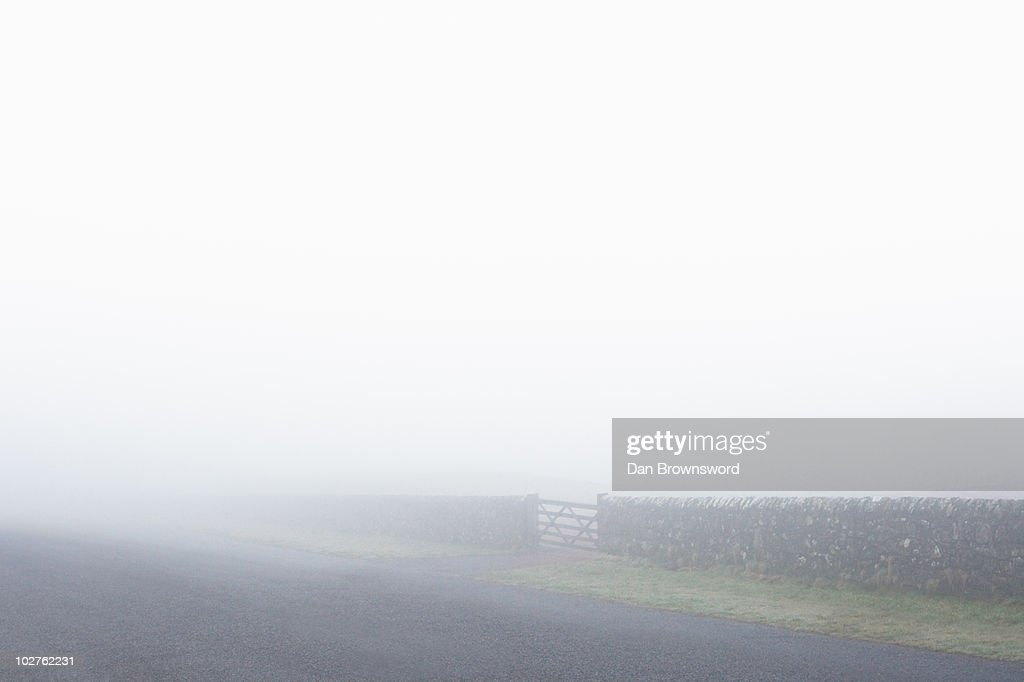 Wall and gate in fog