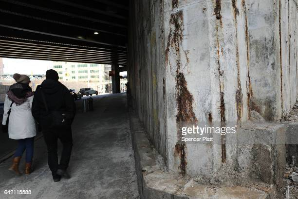 A wall being repaired stands under a bridge in Brooklyn on February 16 2017 in New York City An annual report by the American Road and Transportation...