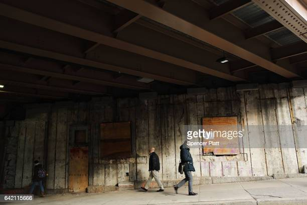 A wall being repaired stands under the Brooklyn Bridge on February 16 2017 in New York City An annual report by the American Road and Transportation...