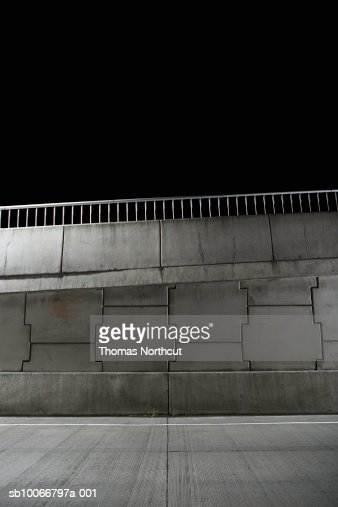 Wall beside road at night : Stock Photo