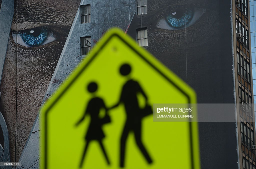 A wall billboard advertising for an upcoming television show is seen on a building in New York on February 25, 2013. AFP PHOTO/EMMANUEL DUNAND