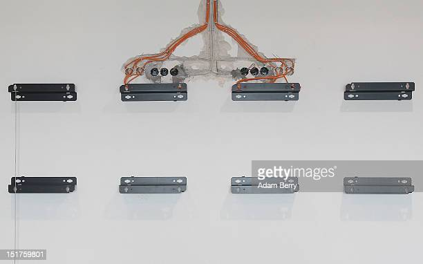 Wall brackets to be used to hold digital flight information panels hang on the construction site of the new Willy Brandt Berlin Brandenburg...