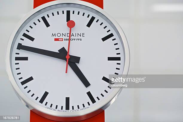 A wall clock in the design of Swiss stateowned railway operator SBB manufactured by Mondaine Watch Ltd hangs on a wall during the Baselworld watch...