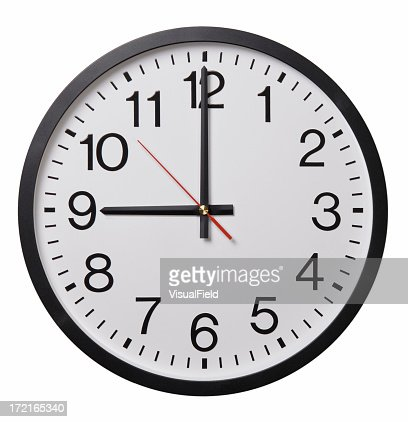 A wall clock reading 900 isolated on white