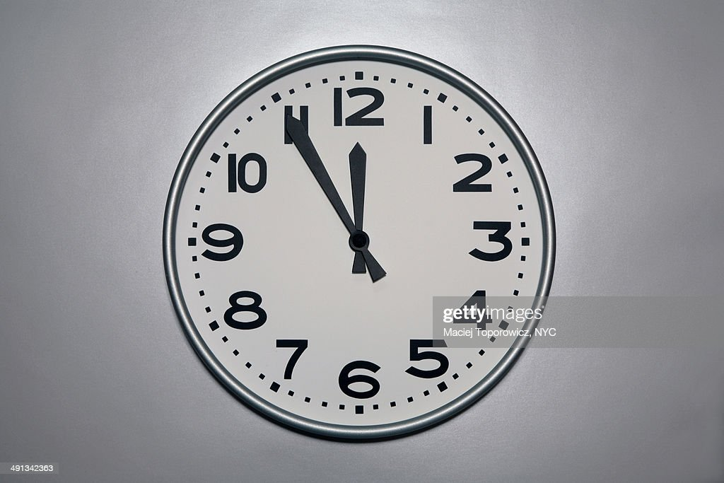 Wall clock with five to noon setting
