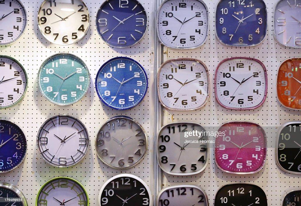 Wall clocks are displayed on the Zhang Zhou Guoda Trading Co Limited stand at the Hong Kong Watch And Clock Fair on September 4, 2013 in Hong Kong, Hong Kong.