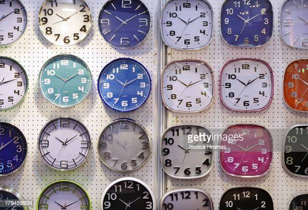 Wall clocks are displayed on the Zhang Zhou Guoda Trading Co Limited stand at the Hong Kong Watch And Clock Fair on September 4 2013 in Hong Kong...