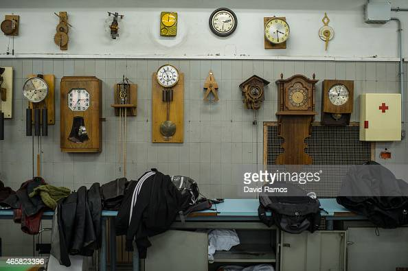Wall clocks hang on the wall of a classroom at the secondary school Mare de Deu de la Merce on March 10 2015 in Barcelona Spain The Watchmaking...