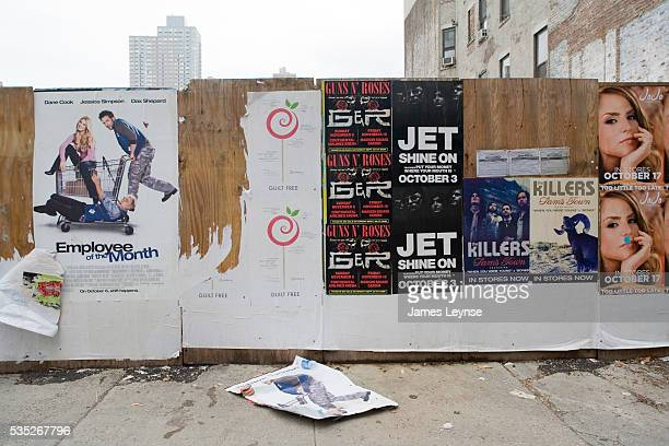 A wall covered with posters on the street in New York