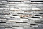 Wall covering for interior made of stoneware with scratched painted wood effect.