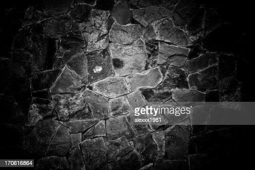 wall facing a stone