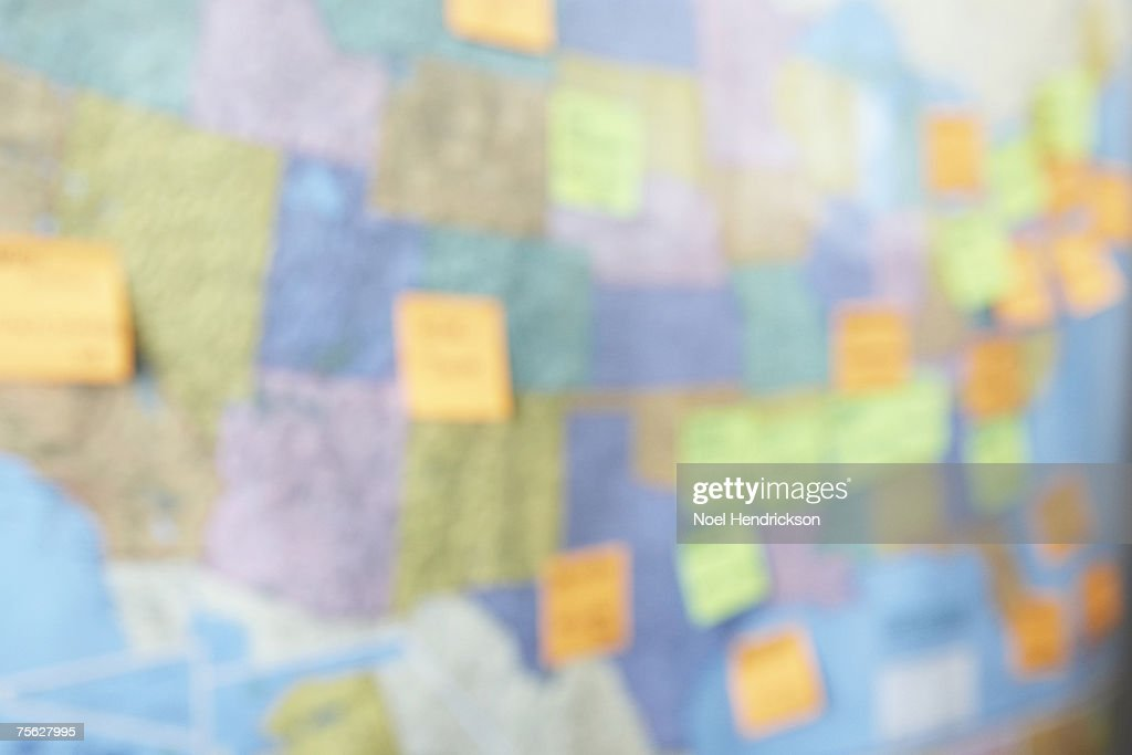 Wall map of USA with adhesive notes, defocused : Stock Photo