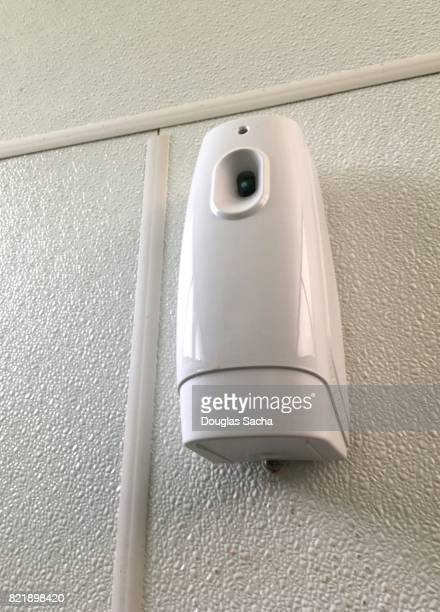 Wall mounted automatic air freshener