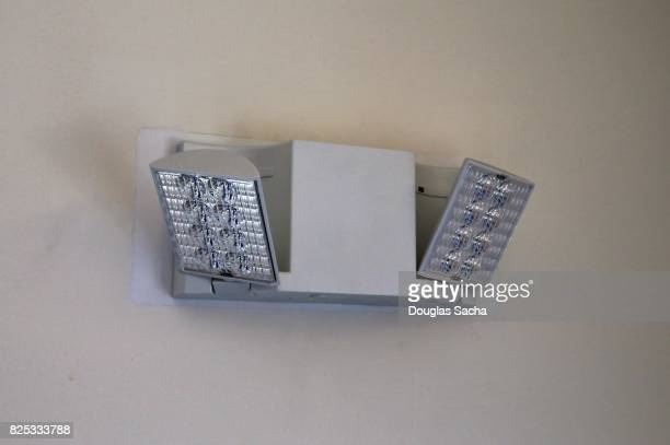 Wall mounted Emergency backup Directional lighting in a public hallway