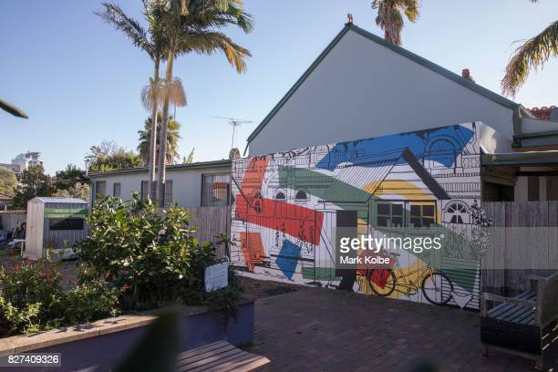 A wall mural by artist Hugues Sineux is seen on a wall bordering the Denison Road Community Garden in Dulwich Hill on August 7 2017 in Sydney...