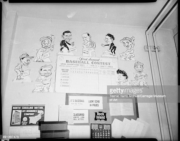 Wall of cartoon caricatures of baseball players with names including Frank Mal Rog Browne and commissioner Lindsey and sign reading 'First annual...