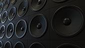 Large arrangement of modern black amplifiers. This image is 3d illustration.