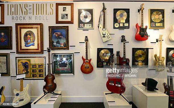 A wall of guitars belonging to rock stars Jimi Hendrix Paul McCartney Ronnie Montrose Jimmy Page and John Doe including Jerry Garcia's top hat are...