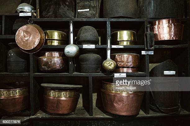 A wall of history at the Sherpa Museum showing clay copper and wooden pots on September 21 2016 in Namche Bazar Nepal The trails in the SoluKhumbu...