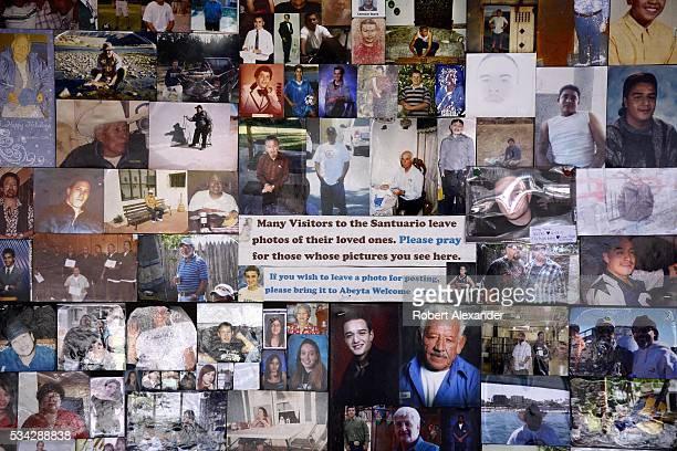 A wall of photographs left by visitors to the Santuario de Chimayo in Chimayo New Mexico on February 27 2016 The Roman Catholic chapel built in 1816...