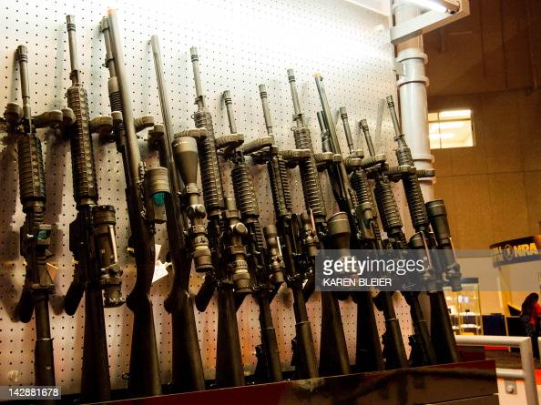 A wall of semiautomatic rifles is seen at the National Rifle Association Annual Meetings and Exhibits April 14 2012 in St Louis Missouri AFP PHOTO /...