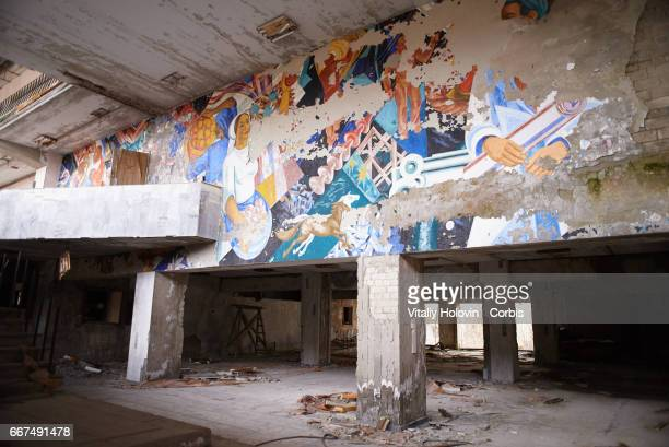 Wall painting in abandoned the building of culture 'Energetic' in the Pripyat near the Chernobyl nuclear power plant in the Exclusion Zone Ukraine...