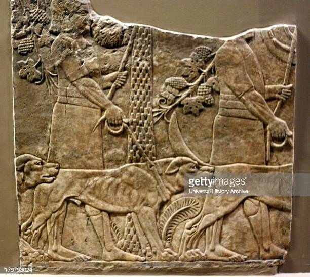 Wall panel depicting huntsmen with hounds in a garden Assyrian approx 645635 BC From the North Palace Nineveh