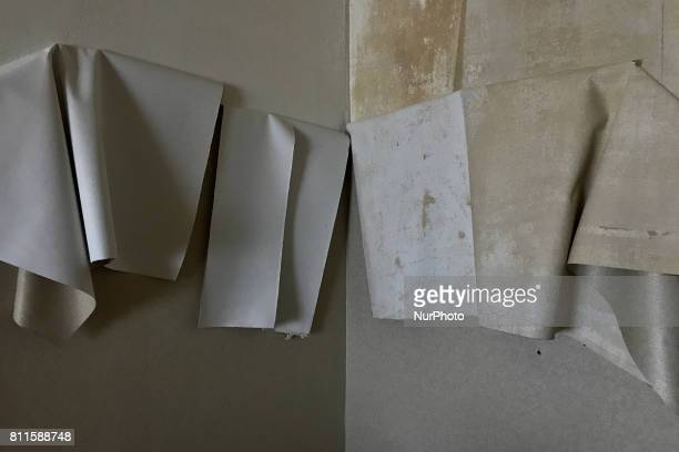 Wall paper hangs from walls during the third day of a liquidation sale at the former Trump Taj Mahal Casino and Resort in Atlantic City New Jersey on...