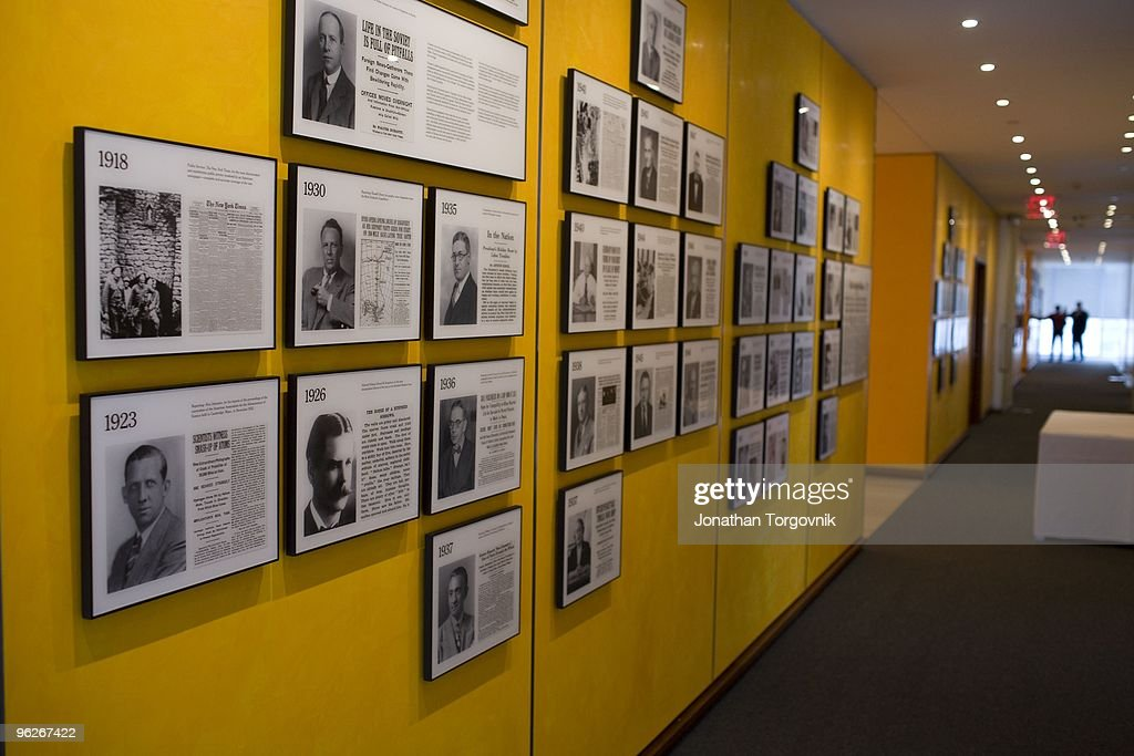 A wall showcasing all the New York Times reporters and photographers that won Pulitzer Prizes in one of the hallways of the New York Times building...