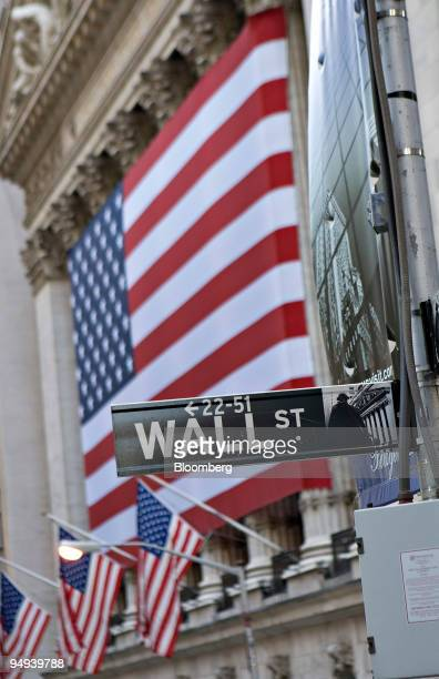 Wall St sign hangs outside the New York Stock Exchange in New York US on Monday April 13 2009 US stocks fell sending the Standard Poor's 500 Index...