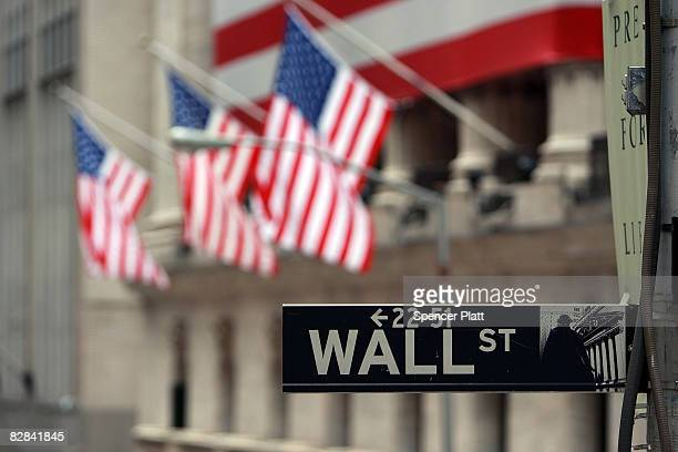 Wall St sign next to the New York Stock Exchange September 16 2008 in New York City US stocks continued to drop Tuesday morning for the second...