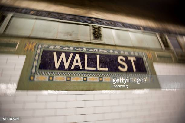 A Wall Street sign is seen inside a subway station near the New York Stock Exchange in New York US on Friday Sept 8 2017 The dollar fell to the...