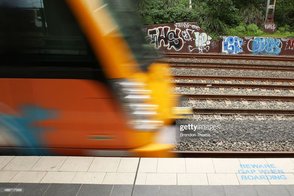 A wall strewn with Graffiti is seen as a train departs Newtown Station on May 8, 2014 in Sydney, Australia. The Grafitti Control Amendment Act passed in the NSW legislative council yesterday includes tougher penalties a the ability for local courts to enforce community clean up duty on offenders.