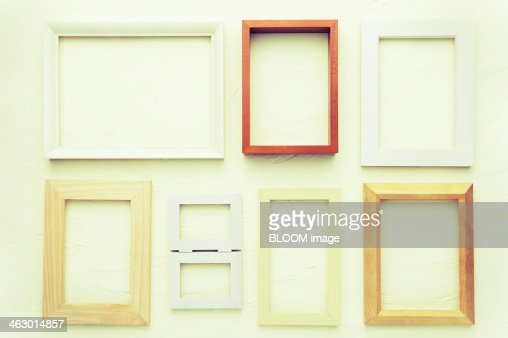 Wall with empty picture frames stock photo getty images for What to do with empty picture frames