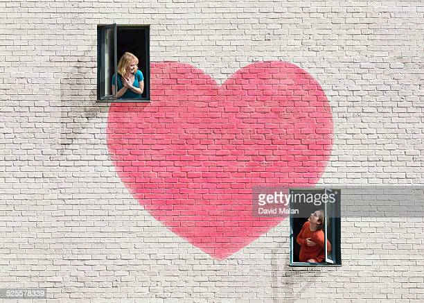 Wall with heart shape & windows & a couple